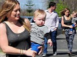 Family day out! Hilary Duff holds son Luca close as she and hubby Mike Comrie make their way to a birthday party