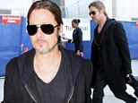 Bonjour Hollywood! Brad Pitt joins the fashion pack in leather trousers as he returns from French break