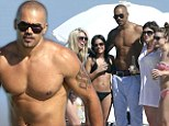 He's a ladies man! Shemar Moore shows off his buff body as he's fawned over by bikini babes on Miami Beach