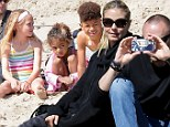 Martin Kristen proves he's part of the family as he snaps photos of Heidi Klum's four children at the beach