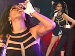 BOOM(erang)! Catsuit-clad Nicole Scherzinger gets some liquid courage as she downs shots on stage for G-A-Y show