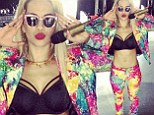 Rita Ora showed off her impressively toned stomach ahead of a performance in Australia on Saturday