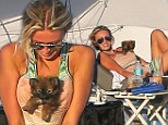 Nice puppy! Wayne Gretzky's daughter Paulina finds an unusual way to carry her new dog... in her cleavage