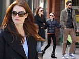 Julianne Moore and her husband Bart Freundlich are the picture of a loving family as they take daughter Liv out in New York's West Village