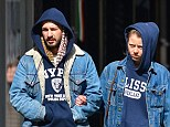 Spot the difference! Couple Shia LaBeouf and Mia Goth morph into the same person as they wear identical outfits and the same glum expression