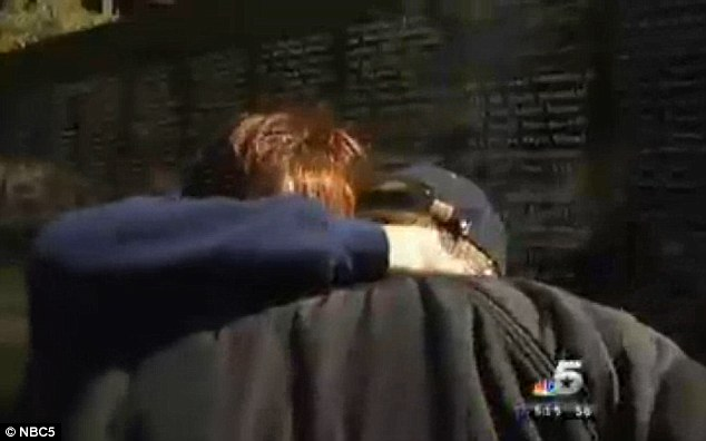 Hits home: Christine Smithson embraces Mr White with tears in her eyes saying that even though her own son's name isn't on that wall, there's a specialist who served with him whose name is