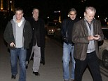 Here come the boys: George Clooney and Matt Damon join John Goodman and Bill Murray for dinner in Berlin on Friday