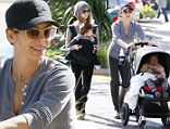 Showing her softer side: Jillian Michaels takes a break from training to join girlfriend Heidi for a day out with the children