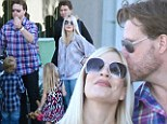 Sunday Funday! Tori Spelling manages to take her big brood to a star studded Hollywood party