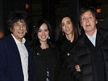 Turning back the clock: Ronnie Wood heads out to dinner with Sir Paul McCartney and their wives on Sunday, proving that time hasn't caught up with their dark locks