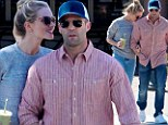 Cheer up Jason! Statham fails to raise a smile as Rosie Huntington-Whiteley showers him with affection