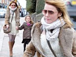 How very (n)ice: Geri Halliwell sports winter white dress as she takes Bluebell to school