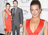 Taking the plunge: Actress Katie Cassidy, age 26, steps out on the PaleyFest carpet with her co-star, Stephen Amell, in Beverly Hills on Saturday in a plunging orange dress