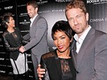 Surprise, surprise! Old smoothie Gerard Butler cuddles up to Angela Bassett at Olympus Has Fallen premiere