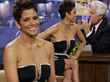 Eyes front Jay! Leno can't help but stare at Halle Berry's cleavage as she wears jaw-droppingly low-cut dress on late night talk show