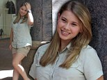 She's got Steve's star power: Bindi Irwin follows in her late father's footsteps as she beams at photo shoot to promote new film