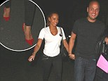 Style over comfort! Mel B livens up her casual outfit with fierce studded red heels as she joins husband Stephen for dinner