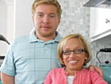 Expanding their family: Dr Jennifer Arnold and Bill Klein, also known as TLC's The Little Couple, pose in their specially adapted kitchen
