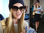 Undercover Angel: Make-up free Candice Swanepoel hides her face with sunglasses and a beanie but still gets swarmed by fans