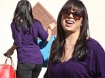 Cheryl Burke flaunts her curves in skintight workout pants as she arrives for Dancing With The Stars' rehearsal
