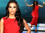 Close call! Eva Longoria almost trips on her long red flowing gown after making a red carpet-worthy entrance in the scoop back scarlet attire