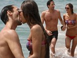 Adrien Brody and his beach babe Lara Lieto heat up the waters in Hawaii with a very passionate kiss