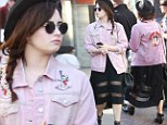 Forgot to look in the mirror? Demi Lovato pairs an ill-fitting sheer dress with a tatty pink jacket on shopping trip with friends