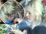 That looks painful! Jennie Garth takes charge and attaches her OWN hair extensions with pliers during salon visit