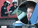 Keeping it in the family! Police stop Rob Kardashian over tinted windows... just a day after Kim was pulled over for same offence