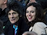 Inseparable: Ronnie Wood and wife Sally Humphries jet to Barcelona to watch the Champion's League match on Tuesday, spending all of their time together