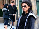 Paring back on the exercise: Pregnant fitness instructor Hilaria Baldwin indulges in a spa treatment as her husband Alec goes for a bike ride