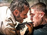 Bloodied and beaten: Robert Pattinson loses his Twilight gloss as he faces a menacing gun-toting Guy Pearce in The Rover