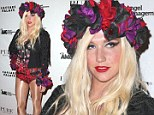 Floral queen: Kesha poses in her elaborate flowery outfit
