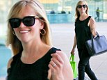 Trimmed down in slimming black: Reese Witherspoon is svelte in skinny trousers as she looks ready to get down to business