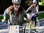 Just cruising solo! Alyson Hannigan leaves her favourite little girls at home as she takes her bicycle for a spin