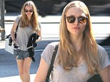 Spring has sprung! Amanda Seyfried flutters out into the sun and puts her porcelain skin on show in a pair of flirty floral shorts