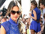 How cheeky! Leggy Alessandra Ambrosio shows a hint of her derriére as she raises hemlines in a striking cobalt lace romper