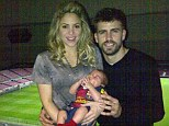 Lucky charm! Gerard Piqué poses with girlfriend Shakira and their baby son Milan, decked out in a FC Barcelona kit, following the team's victorious game against AC Milan on Tuesday night
