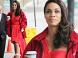 Dressing up and dressing down! Rosario Dawson looks glamorous in a leg-revealing red dress.... but pairs the look with UGG boots
