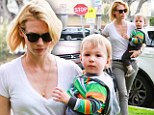 Mad for monochrome: January Jones is stylish in black and white striped trousers as she carries her colourfully dressed son Xander