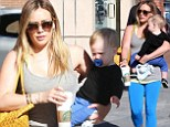 Nice way to get a workout! It's a juggling act for Hilary Duff as she carries little Luca in one arm... and a heavy bag on the other