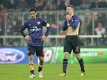 Gutted: Arsenal's Mikel Arteta, left, and Laurent Koscielny leave the field after their Champions League exit