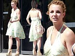 Blooming lovely! Britney Spears ditches the tracksuits and polo necks to wear gorgeous floral halterneck dress