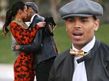 Don't let Rihanna catch you! Chris Brown gets familiar with his female co-star as he shoots new music video