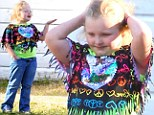 The hippie hippie shake! Honey Boo Boo turns flower child as she tries out new style while filming reality show