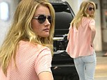 Want to look like me? Drink 8 glasses of water a day! Rosie Huntington-Whiteley reveals her diet secret as she shows off slim figure in skintight jeans