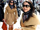 Power dressing! Newly-single Bethenny Frankel puts in a confident turn in her favourite caped coat and knee-high boots