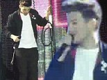 Louis Tomlinson of One Direction limping on stage