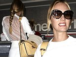 No need for a body scan, then! Candice Swanepoel brings sexy back in see-through white top as she stalks through airport