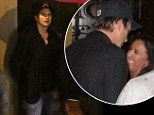 Don't stand so close to me! Ashton Kutcher parties with a female fan at Texas festival while girlfriend Mila Kunis is in London